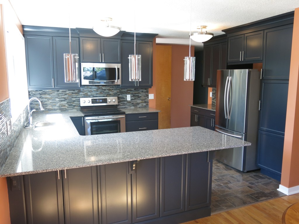 Black cabinets, with granite countertop and stainless steel appliances