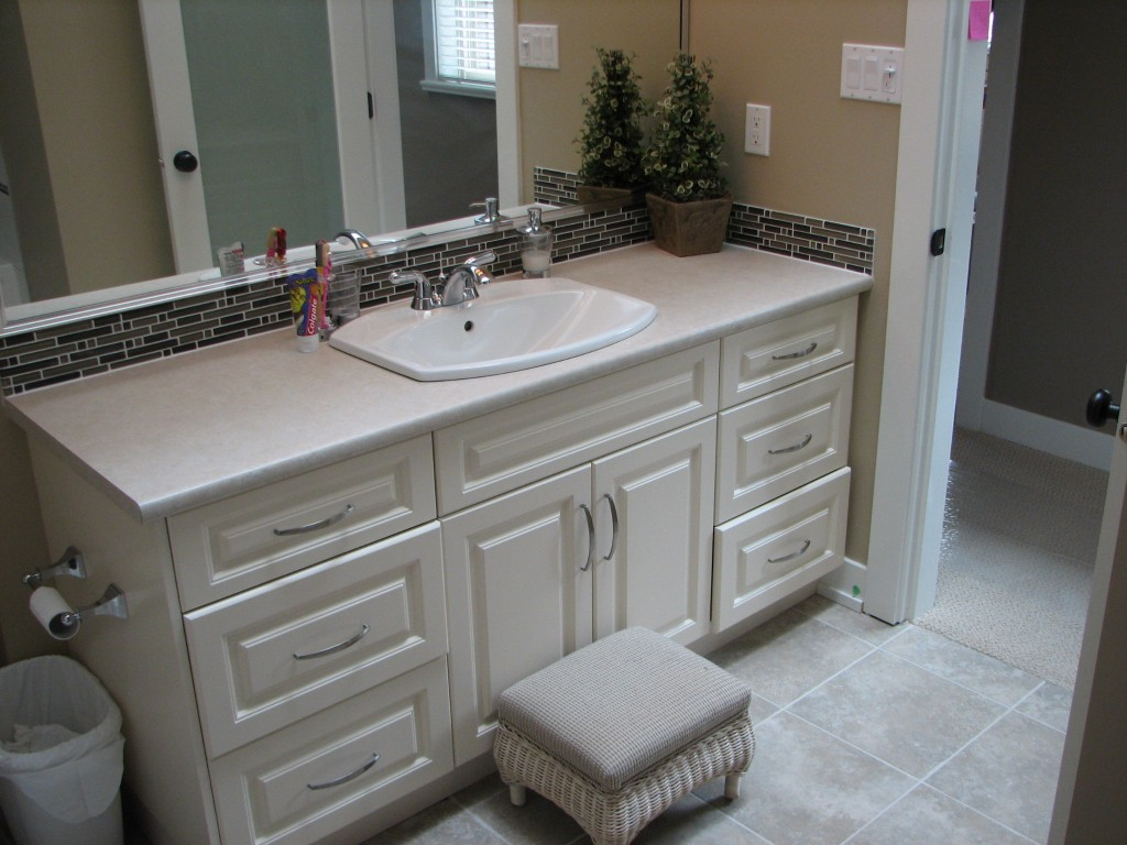 Bathroom Renovation With White Vanity And Tile Backsplash